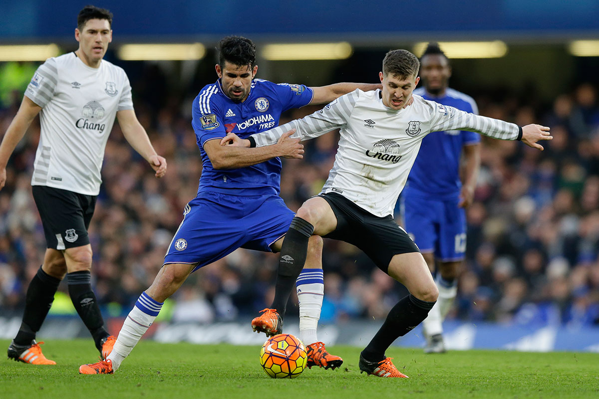 John Stones fights for the ball