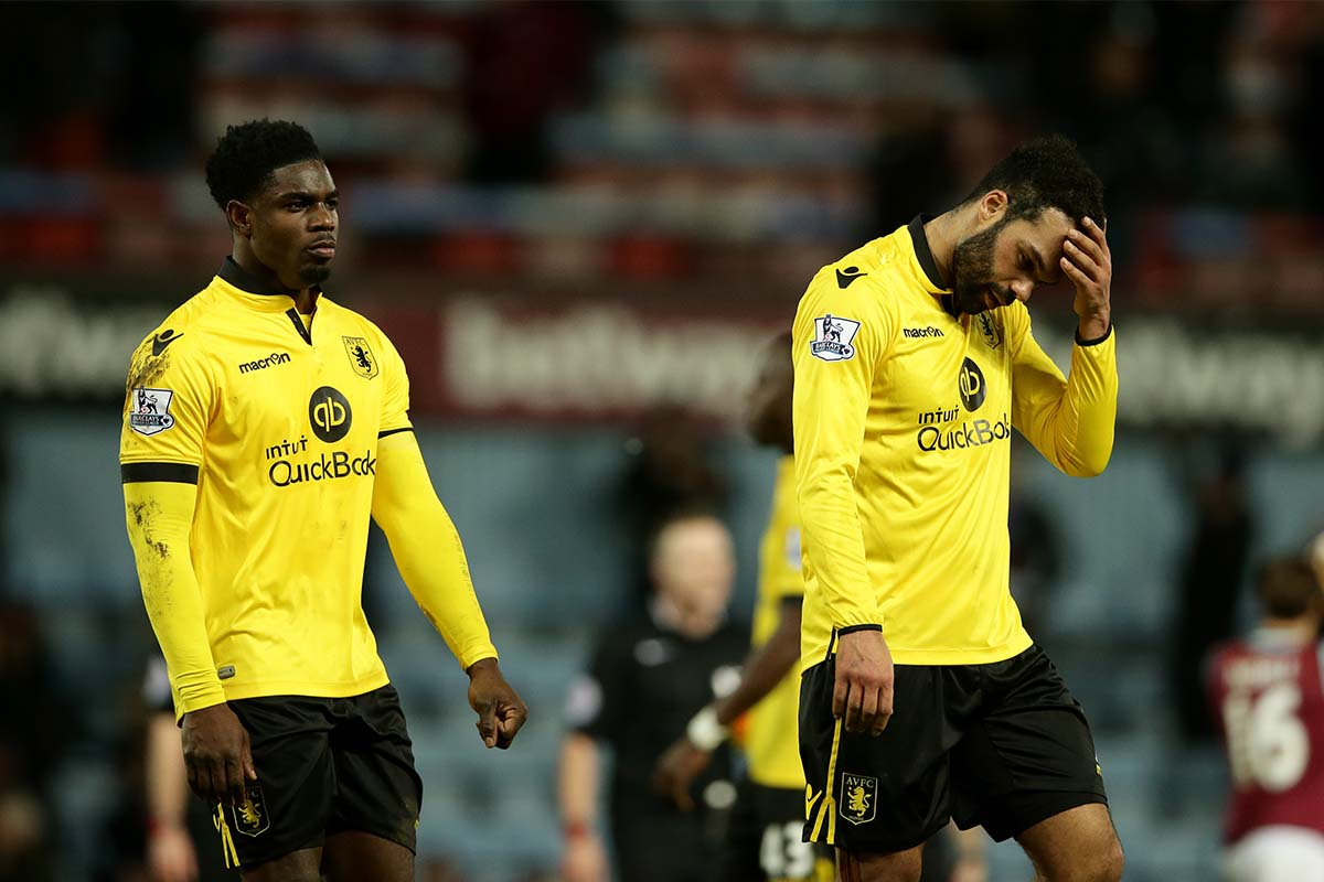 Aston Villa look dejected after their defeat