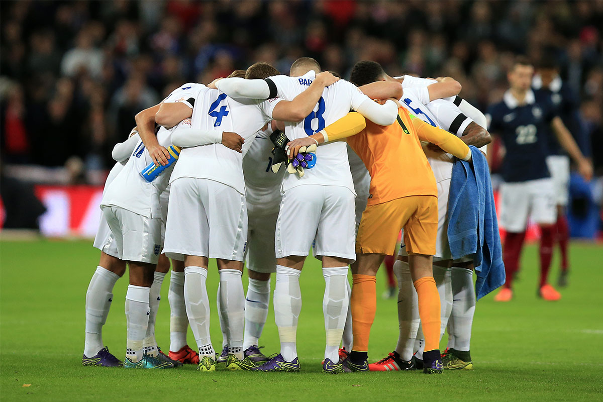 The England football team huddle before the game