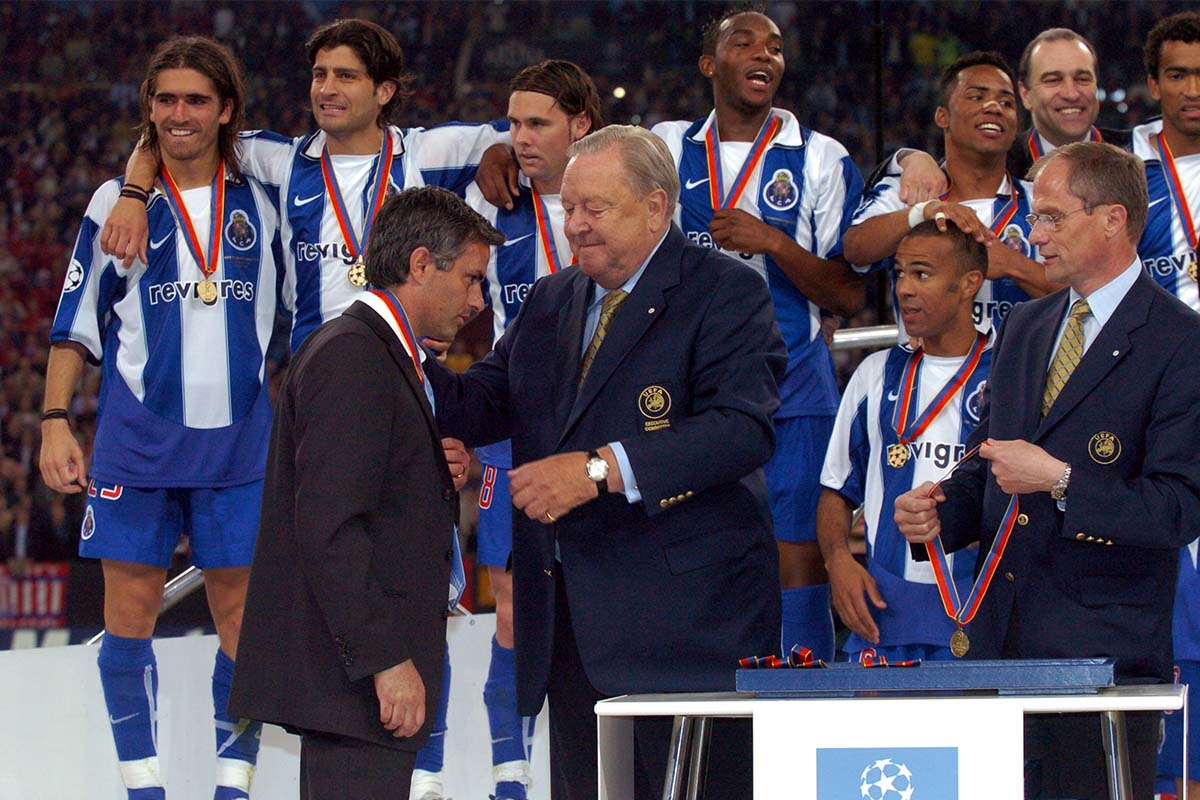 Jose Mourinho collects his winners medal