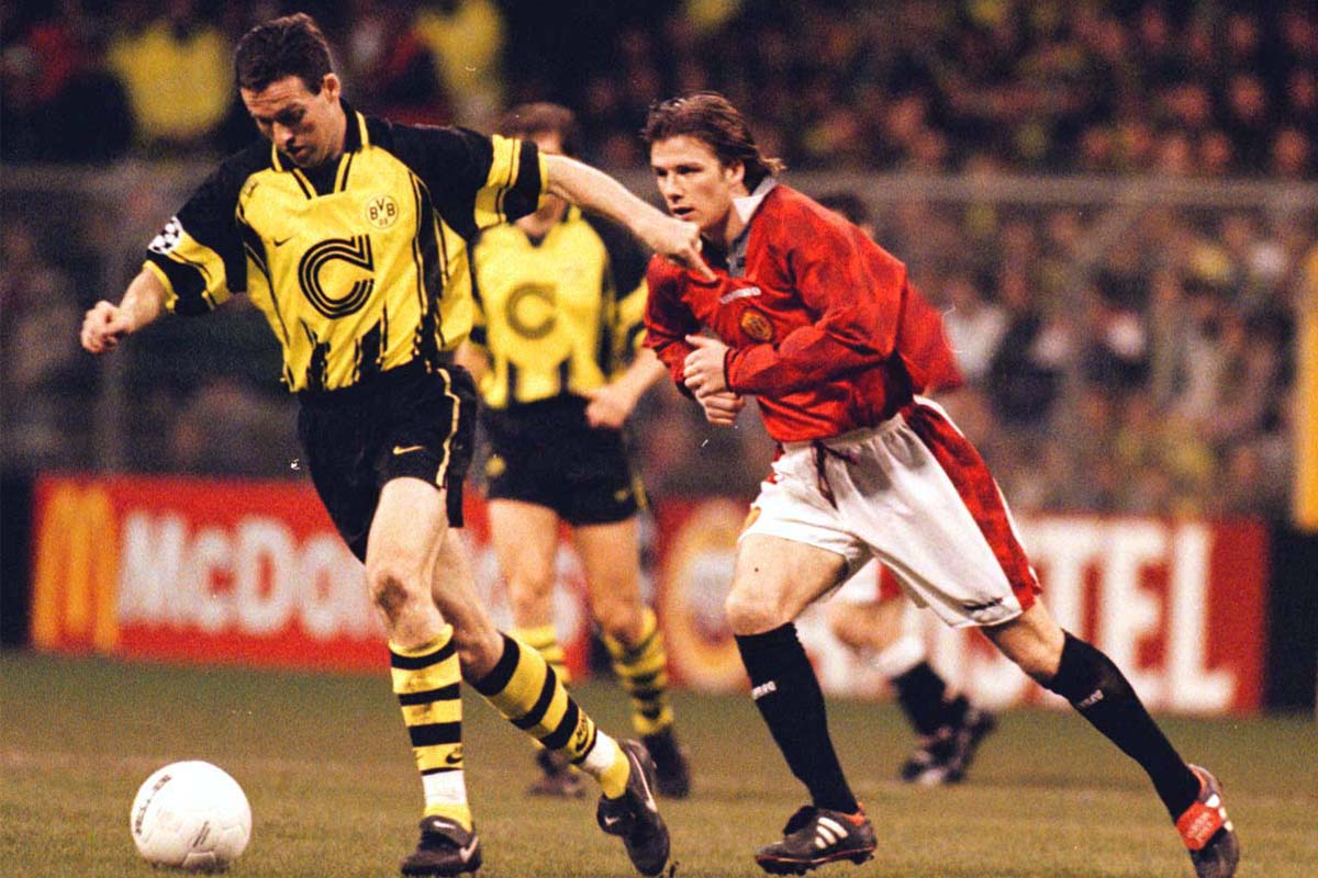Dortmund's Paul Lambert chased by David Beckham