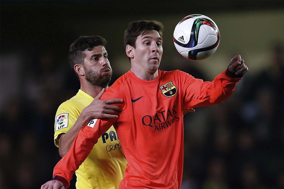 Mateo Musacchio duels Lionel Messi for the ball
