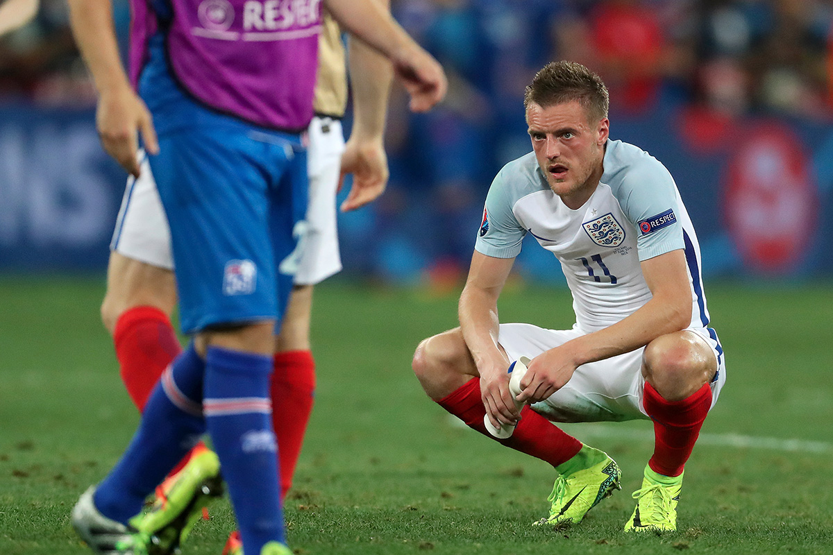 Jamie Vardy looks dejected after England's loss