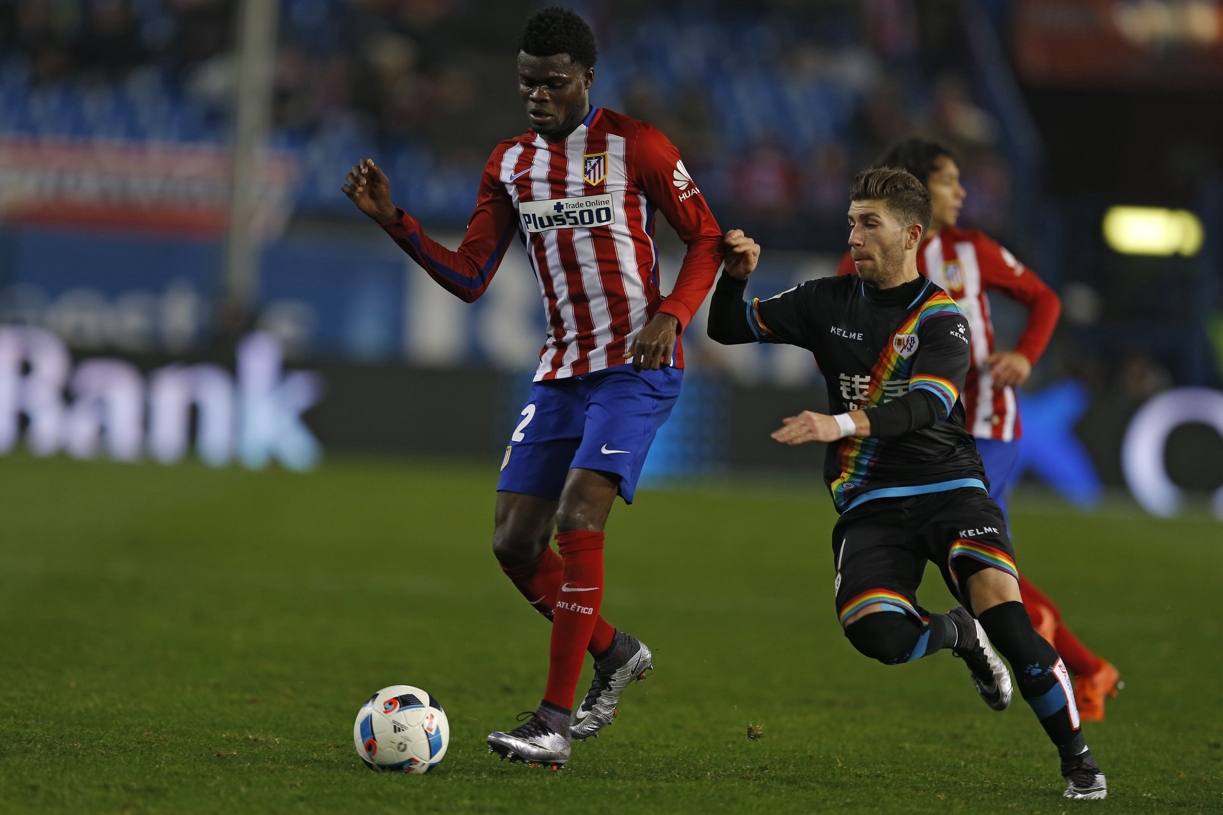 Atletico Madrid's Thomas Partey, left, tussles for the ball with Rayo Vallecano's Adrian Embarba during the Copa del Rey second leg soccer match between Atletico Madrid and Rayo Vallecano at the Vicente Calderon stadium, in Madrid, Thursday, Jan. 14, 2016. Atletico Madrid won 4-1 on aggregate and moved to the next round. (AP Photo/Francisco Seco)