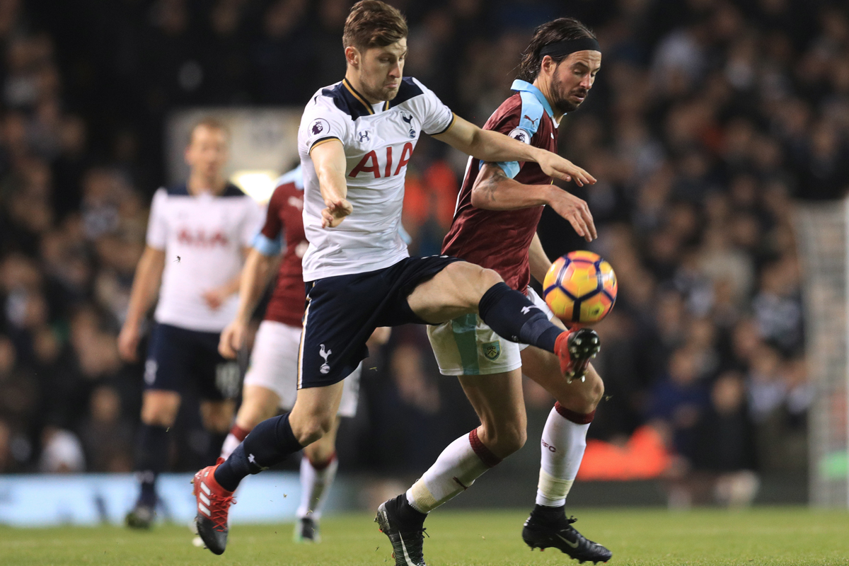 Ben Davies takes on Burnley's George Boyd