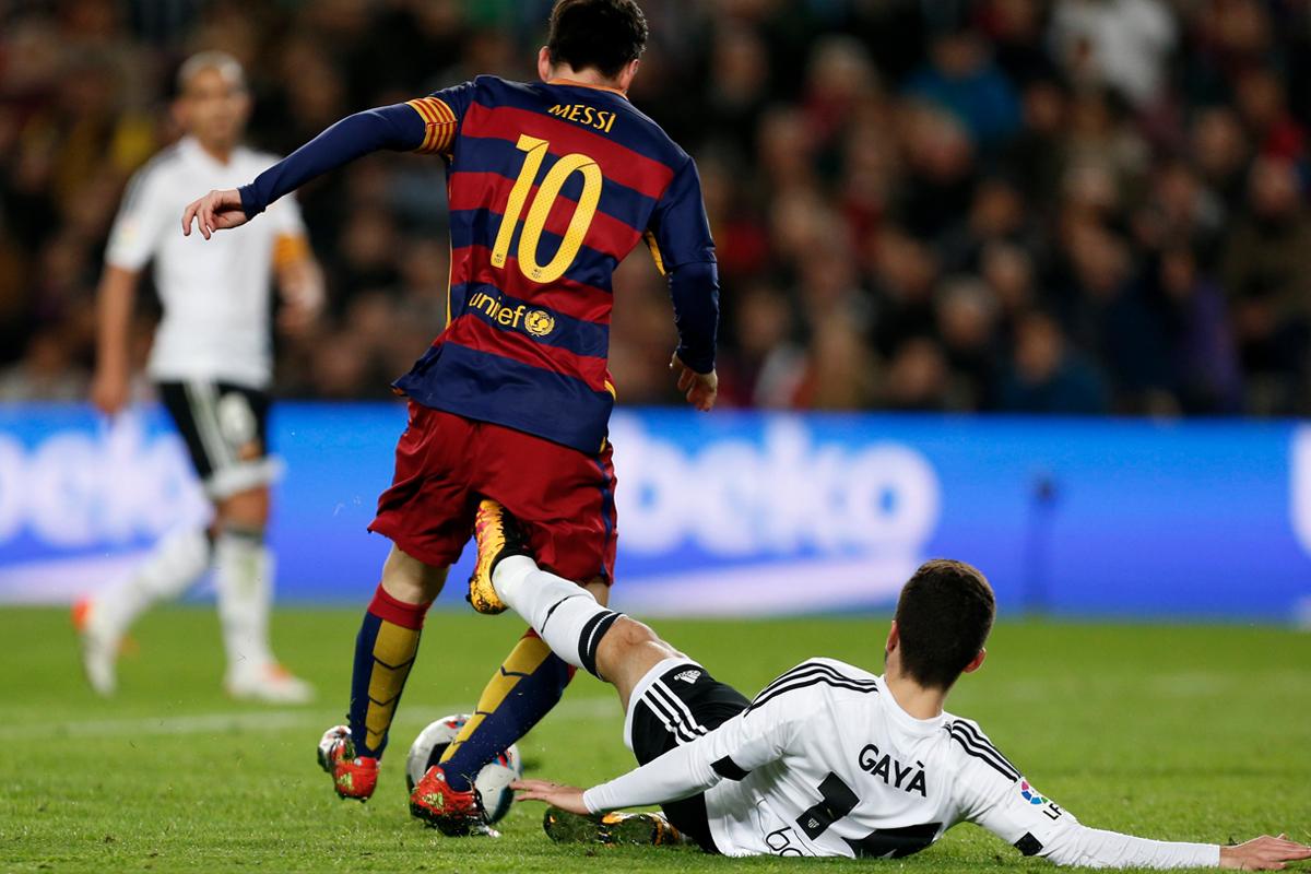 Jose Luis Gaya, tackling Lionel Messi here, is an Arsenal transfer target