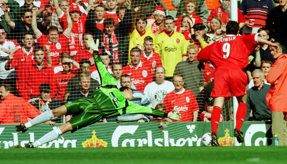 This picture may only be used within the context of an editorial feature. Liverpool's Robbie Fowler beats Everton goalkeeper Thomas Myre to score from the penalty spot during their FA Premiership match at Anfield. Liverpool won the match 3-2. * Merseyside derby