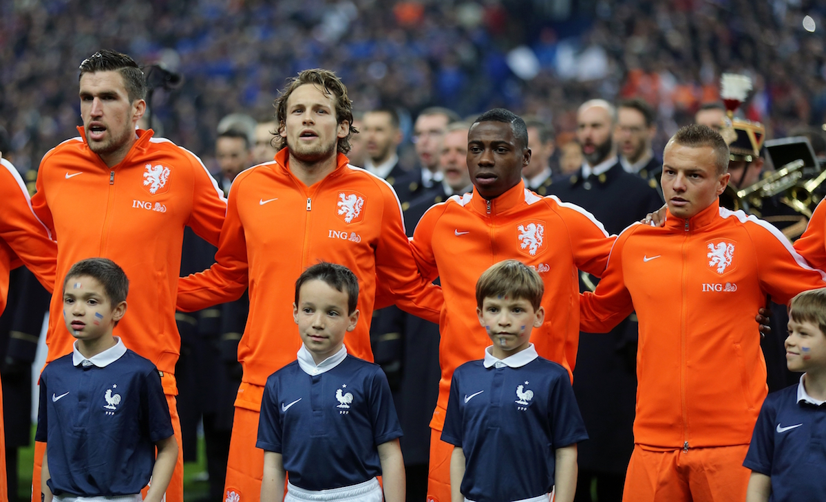 Netherlands players sing their national anthem before the friendly soccer match between France and Netherlands at the Stade de France in Saint Denis, north of Paris, Wednesday March 5, 2014. From left: Kevin Strootman, Daley Blind, Quincy Promes, Jordy Clasie.(AP Photo/Remy de la Mauviniere)