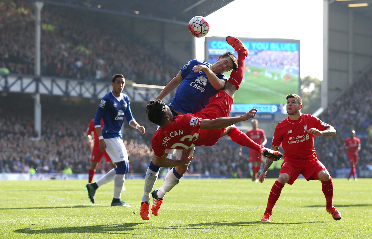 Liverpool's Emre Can kicks Everton's Gareth Barry (left) in the head whilst attempting a overhead kick