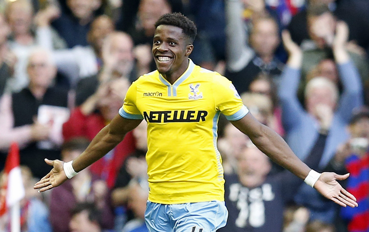 Crystal Palace's Wilfried Zaha celebrates after scoring his side's second goal during the English Premier League soccer match between Liverpool and Crystal Palace at Anfield Stadium, Liverpool, England, Saturday, May 16, 2015. (AP Photo/Jon Super)