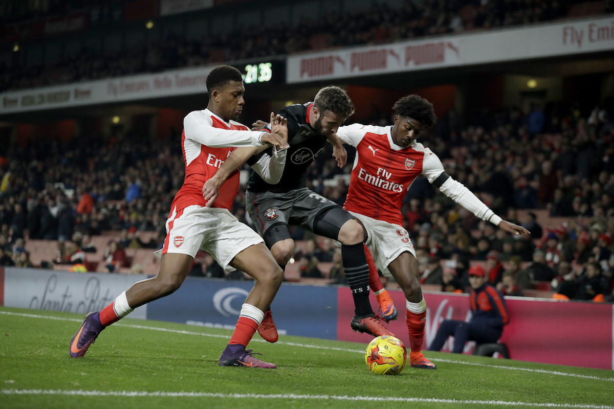 Arsenal's Alex Iwobi, left, and Ainsley Maitland-Niles, right, compete with Southampton's Sam McQueen during the English League Cup quarterfinal soccer match between Arsenal and Southampton at the Emirates stadium in London, Wednesday, Nov. 30, 2016. (AP Photo/Matt Dunham)