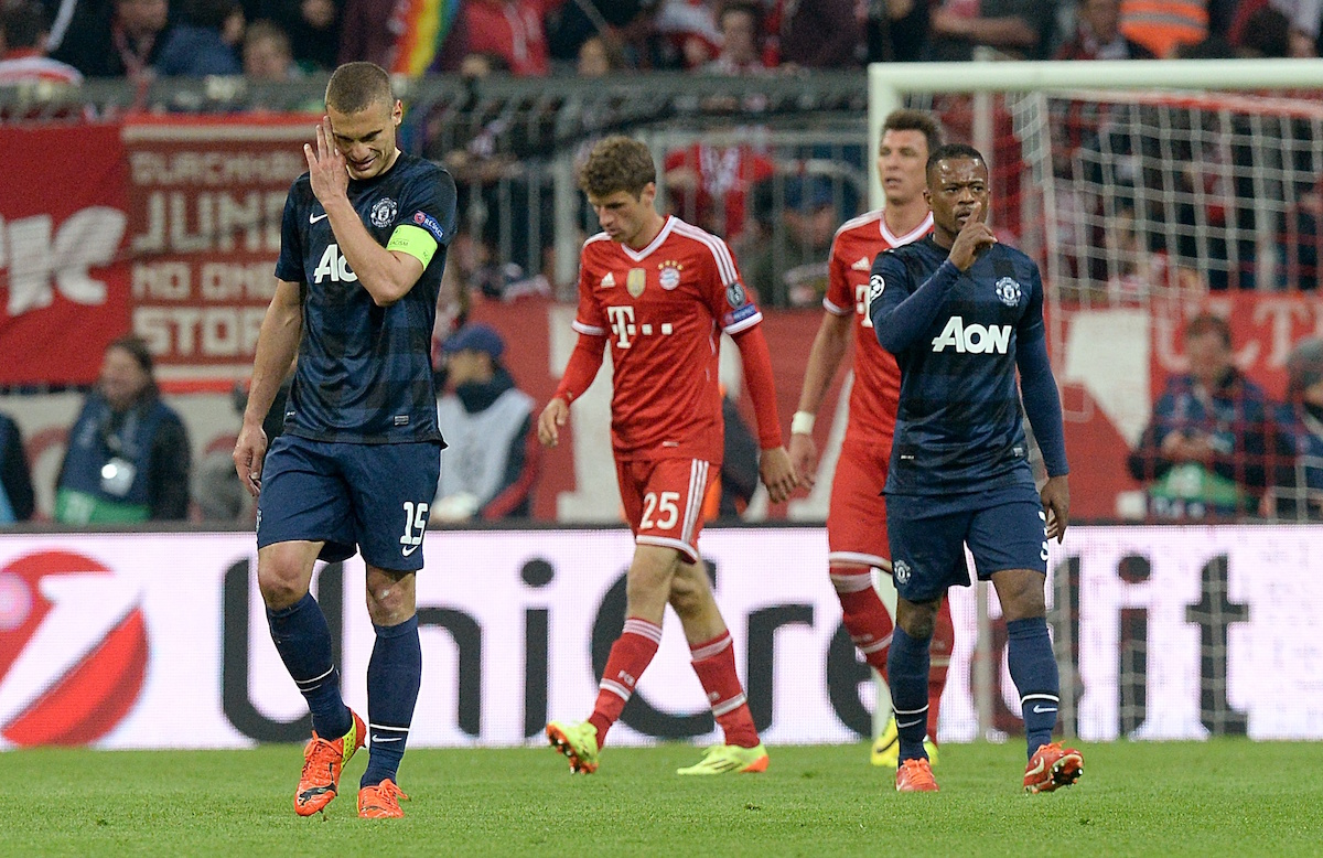 Manchester United's Nemanja Vidic (left) and Patrice Evra look dejected after Bayern Munich's Thomas Muller scores his side's second goal