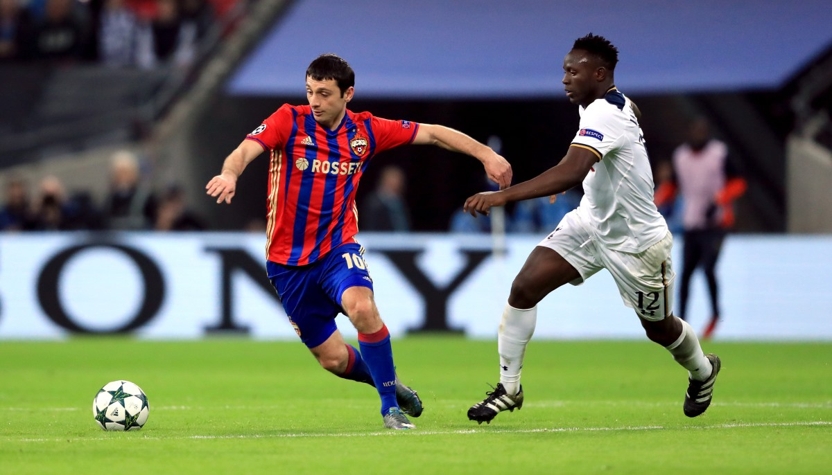 CSKA Moscow's Alan Dzagoev fends off Tottenham's Victor Wanyama in the Champions League