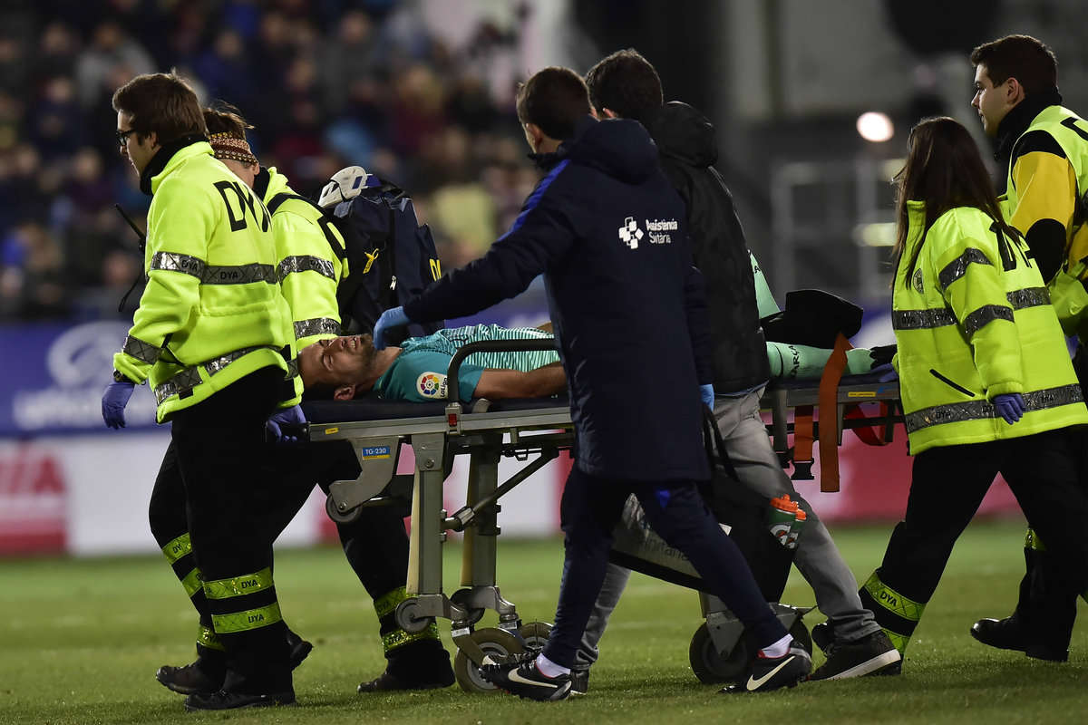 Sergio Busquets is stretchered off with an injury