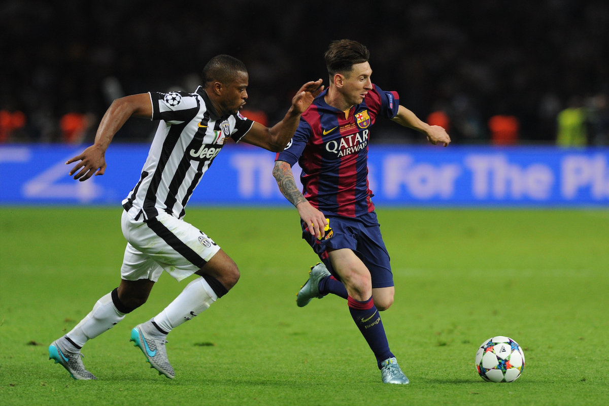 Patrice Evra challenges Lionel Messi