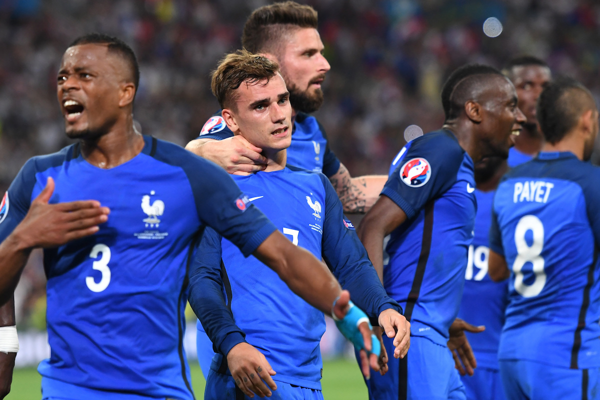 Patrice Evra celebrates for France