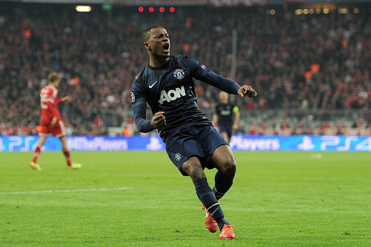 Patrice Evra celebrates scoring against Bayern Munich for Manchester United