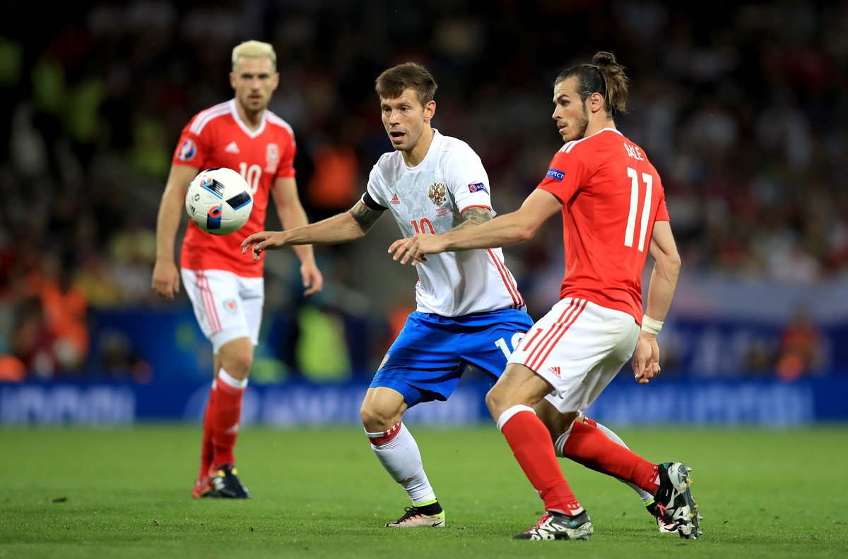 Fedor Smolov, here playing for Russia, skips past Gareth Bale