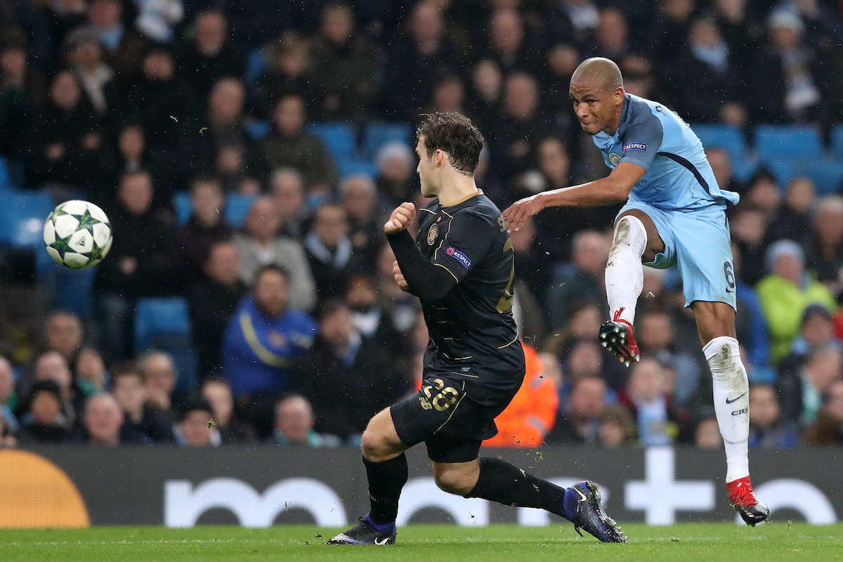 Manchester City's Fernando (right) hits a shot towards goal under pressure from Celtic's Erik Sviatchenko