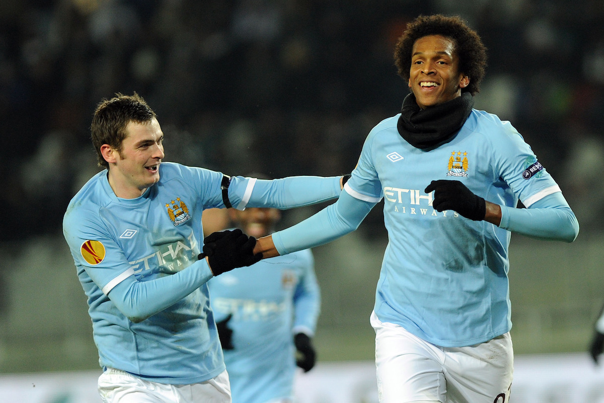 Manchester City's Jo, right, celebrates with teammate Adam Johnson after scoring during the Europa League