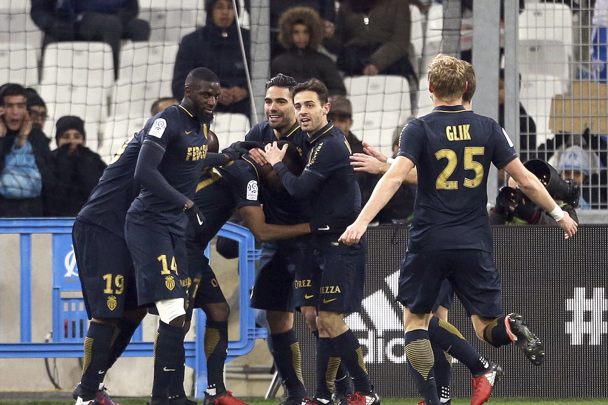 Monaco's players celebrateafter Monaco's midfielder Thomas Lemar, center, scored against Marseille, during the League One soccer match between Marseille and Monaco, at the Velodrome