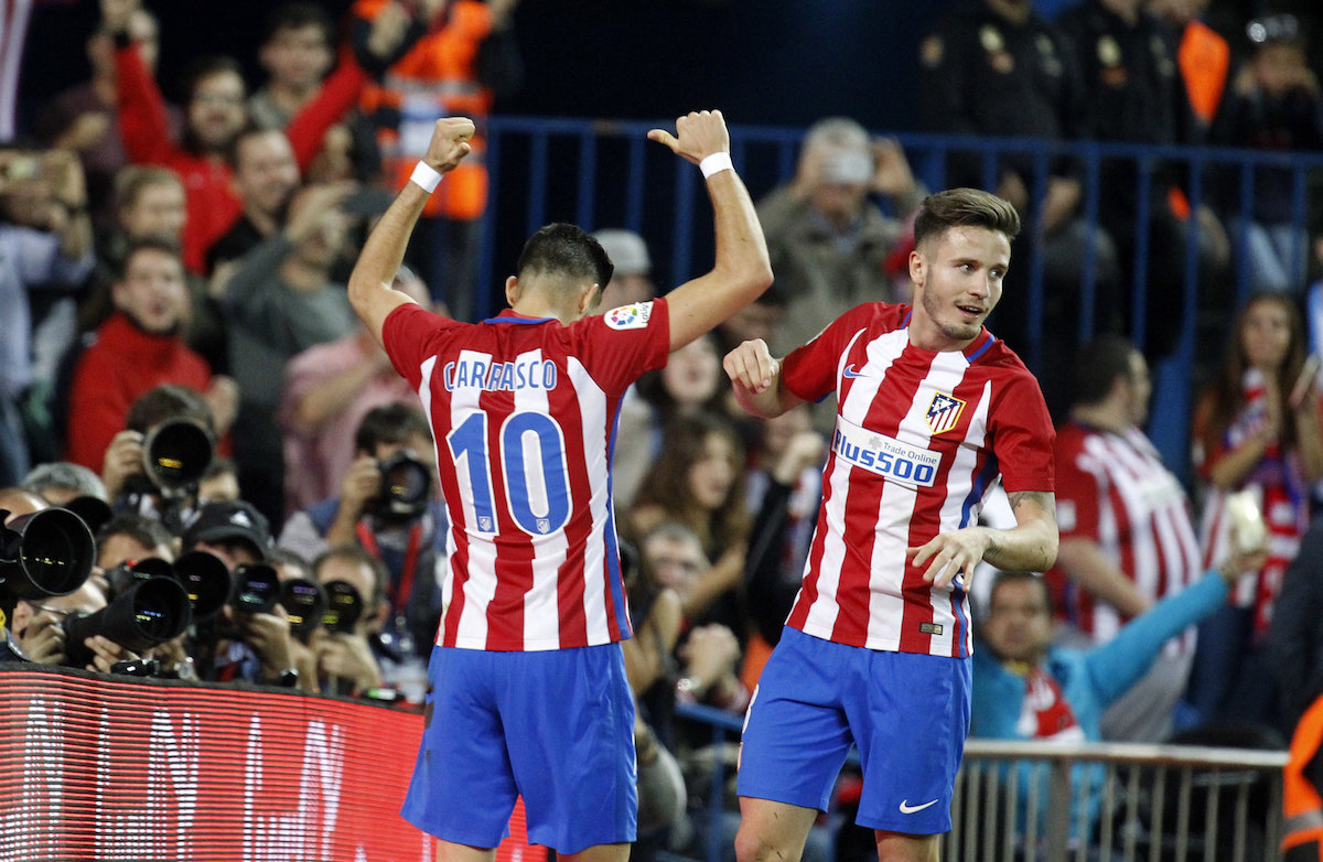 Saul Niguez and Yannick Carrasco of Atletico Madrid