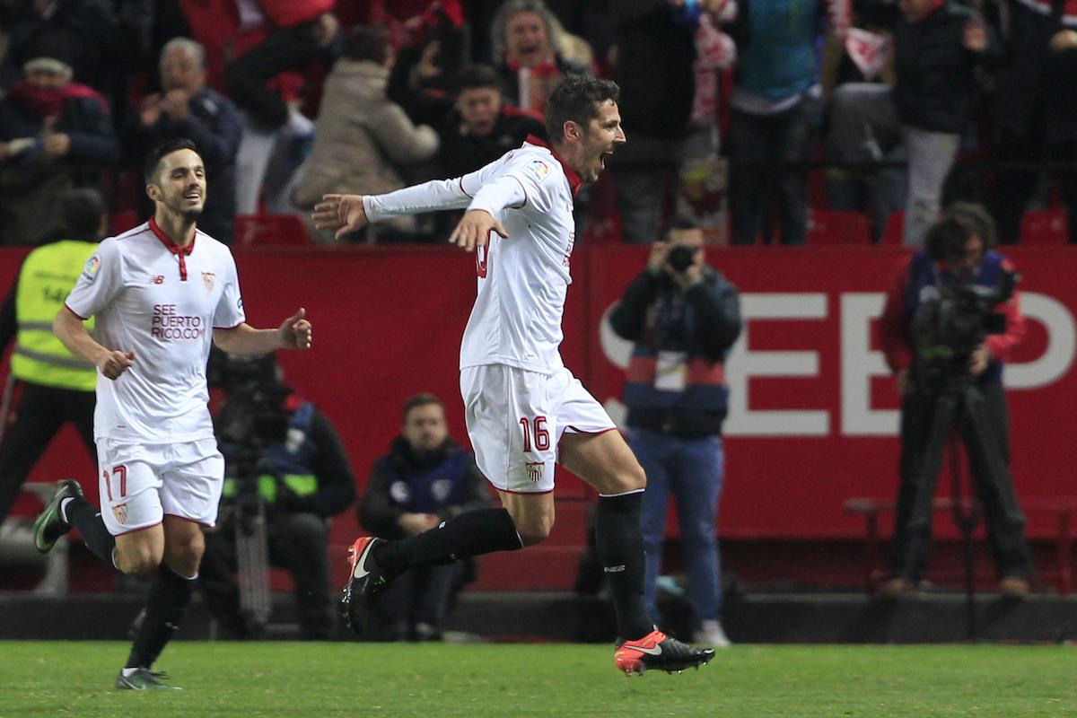 Sevilla's Stevan Jovetic, right, celebrates celebrates after scoring during La Liga soccer match between Real Madrid and Sevilla at the Ramon Sanchez Pizjuan stadium, in Seville, Spain on Sunday, Jan. 15, 2017. Sevilla won 2-1.