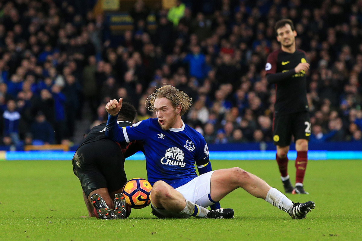 Raheem Sterling (left) tangles with Everton's Tom Davies during the Premier League match at Goodison Park, Liverpool.
