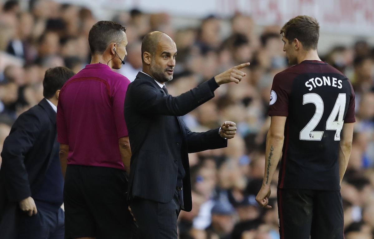 Pep Guardiola talking to John Stones