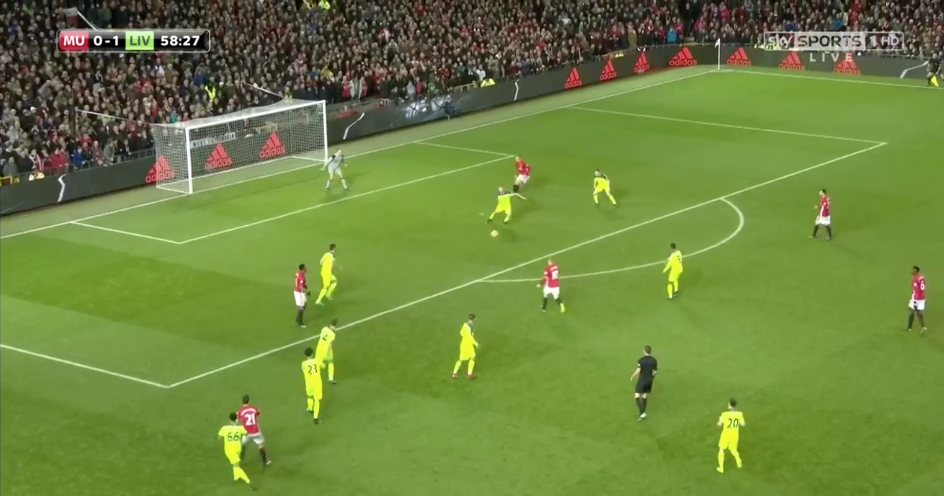Liverpool clear a cross delivered by Ander Herrera