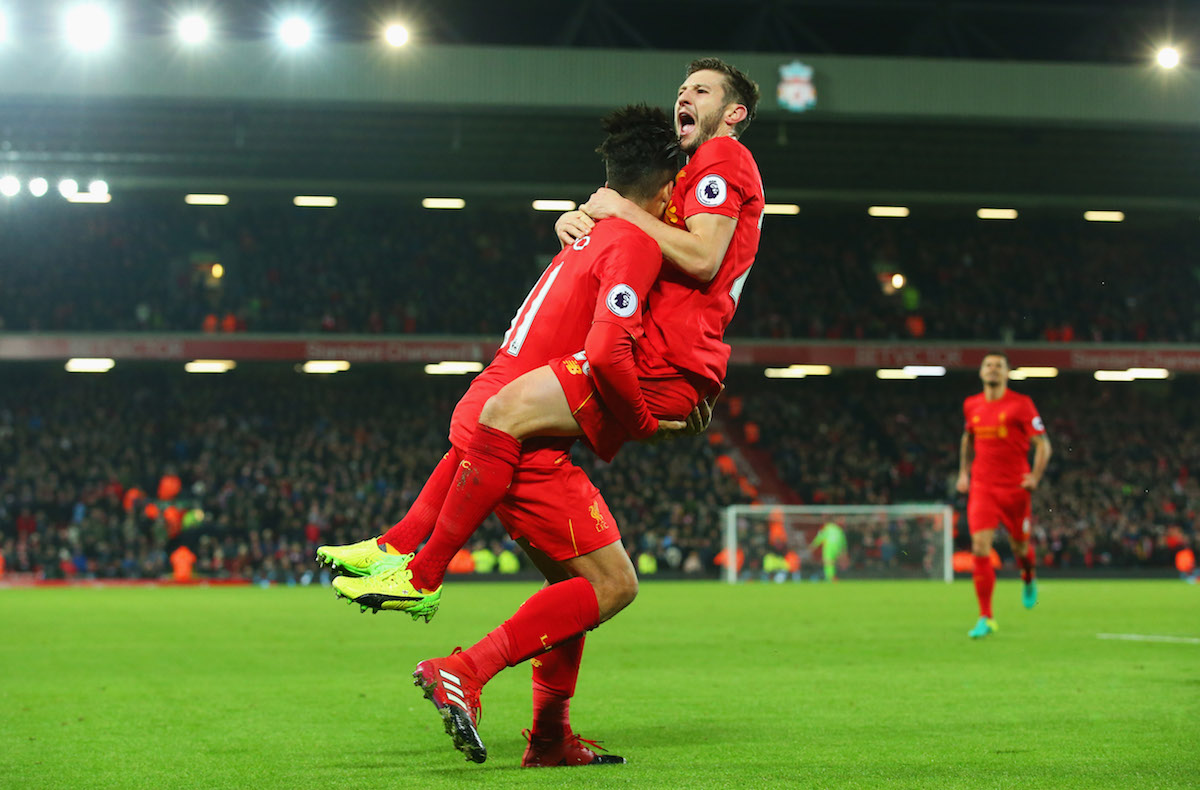 LIVERPOOL, ENGLAND - DECEMBER 27: Roberto Firmino of Liverpool (L) celebrates with Adam Lallana as he scores their second goal during the Premier League match between Liverpool and Stoke City at Anfield on December 27, 2016 in Liverpool, England. (Photo by Alex Livesey/Getty Images)