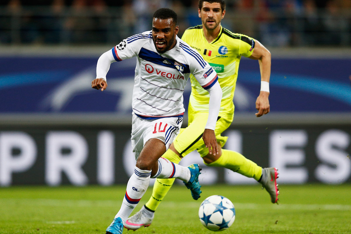 Alexandre Lacazette of Lyon battles for the ball with Stefan Mitrovic of Gent