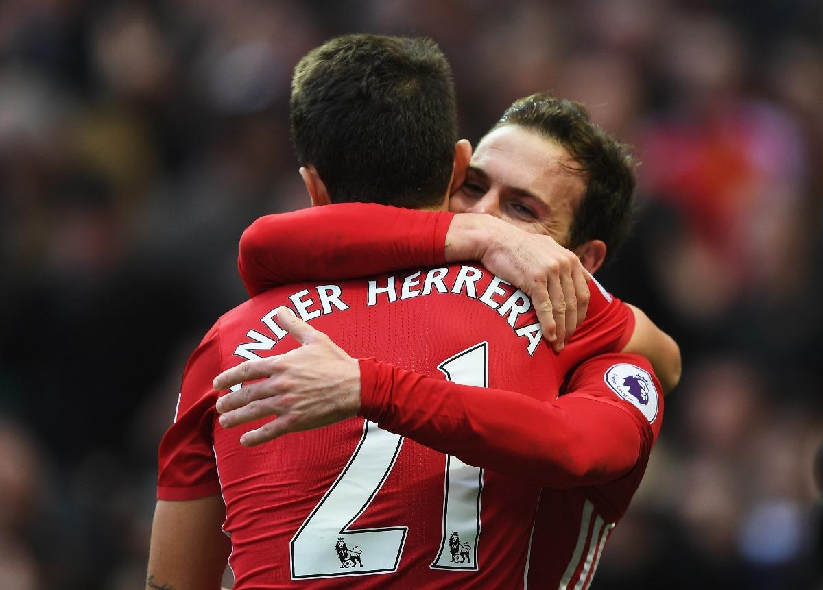 Ander Herrera embraces Juan Mata