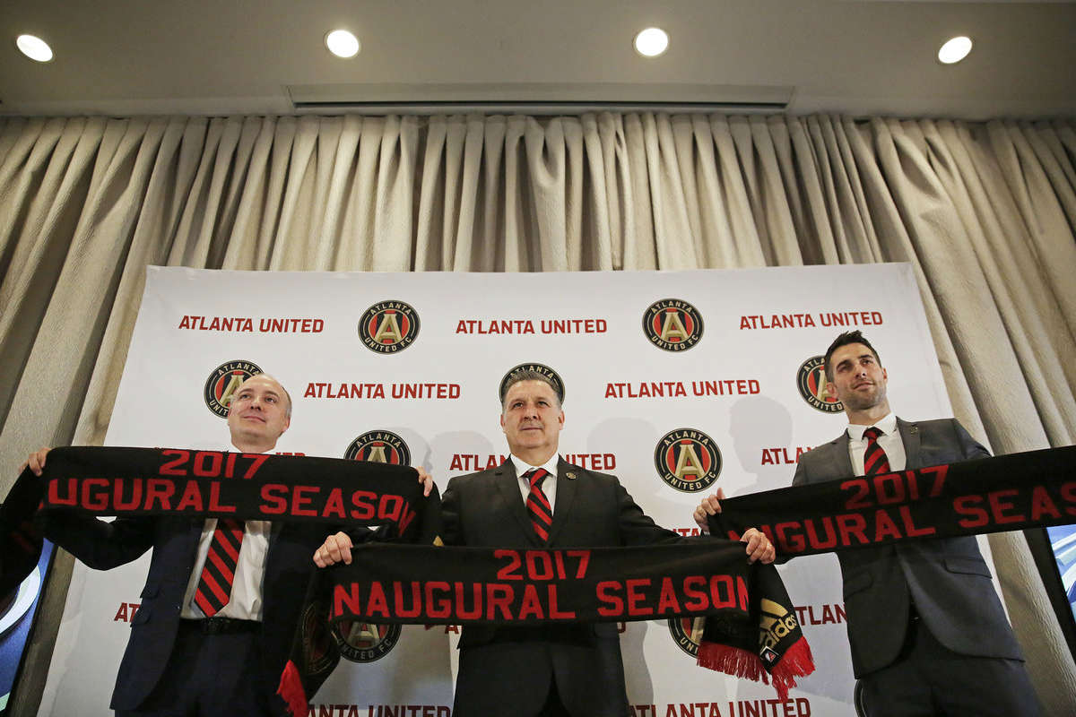Tata Martino with Atlanta United's president, one of the latest MLS expansion sides.