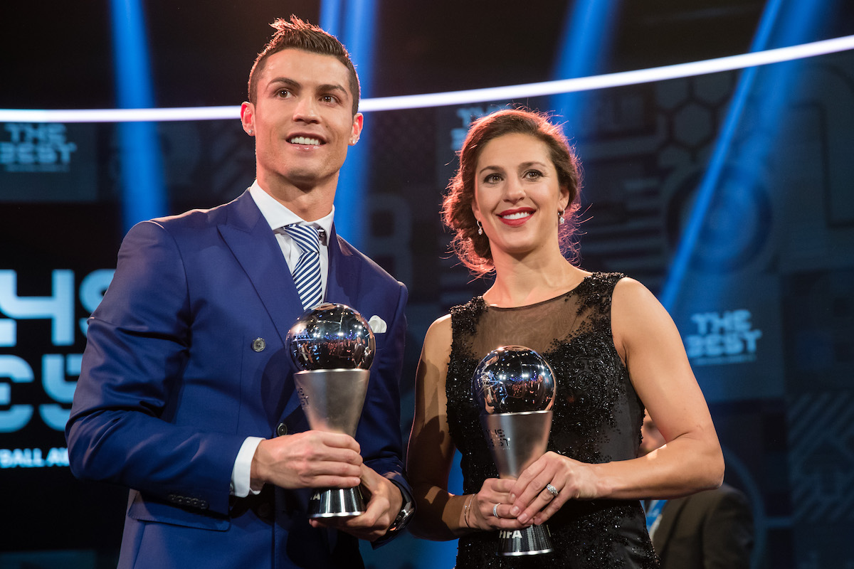 Cristiano Ronaldo of Portugal and Real Madrid and The Best FIFA Women's Player Award winner Carli Lloyd of the United States and Houston Dash pose for a photo