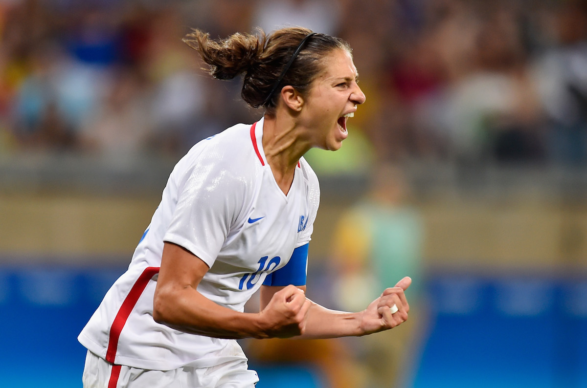 Carli Lloyd of United States celebrates after scoring during the Women's Group G first round match between United States and France
