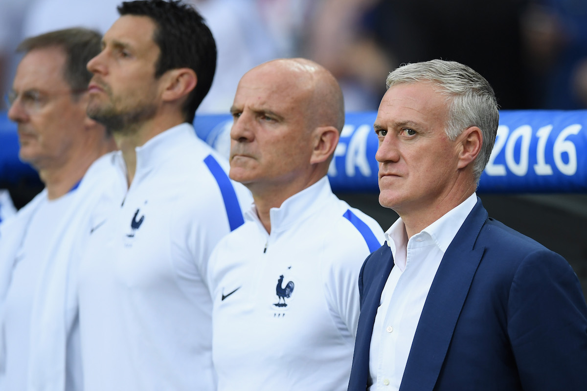 Didier Deschamps (1st R) manager of France and his team staffs line up for the national anthem