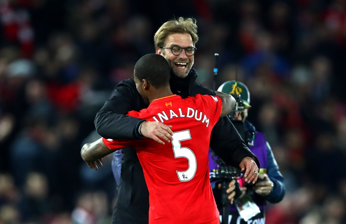 Georginio-Wijnaldum and Jurgen Klopp share a hug