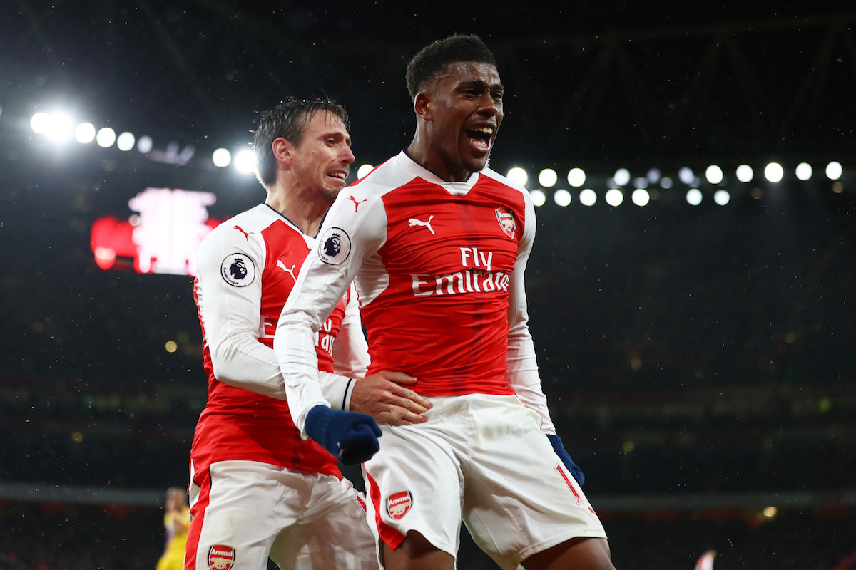 Alex Iwobi of Arsenal celebrates with teammate Nacho Monreal (L) after scoring his team's second goal during the Premier League match between Arsenal and Crystal Palace