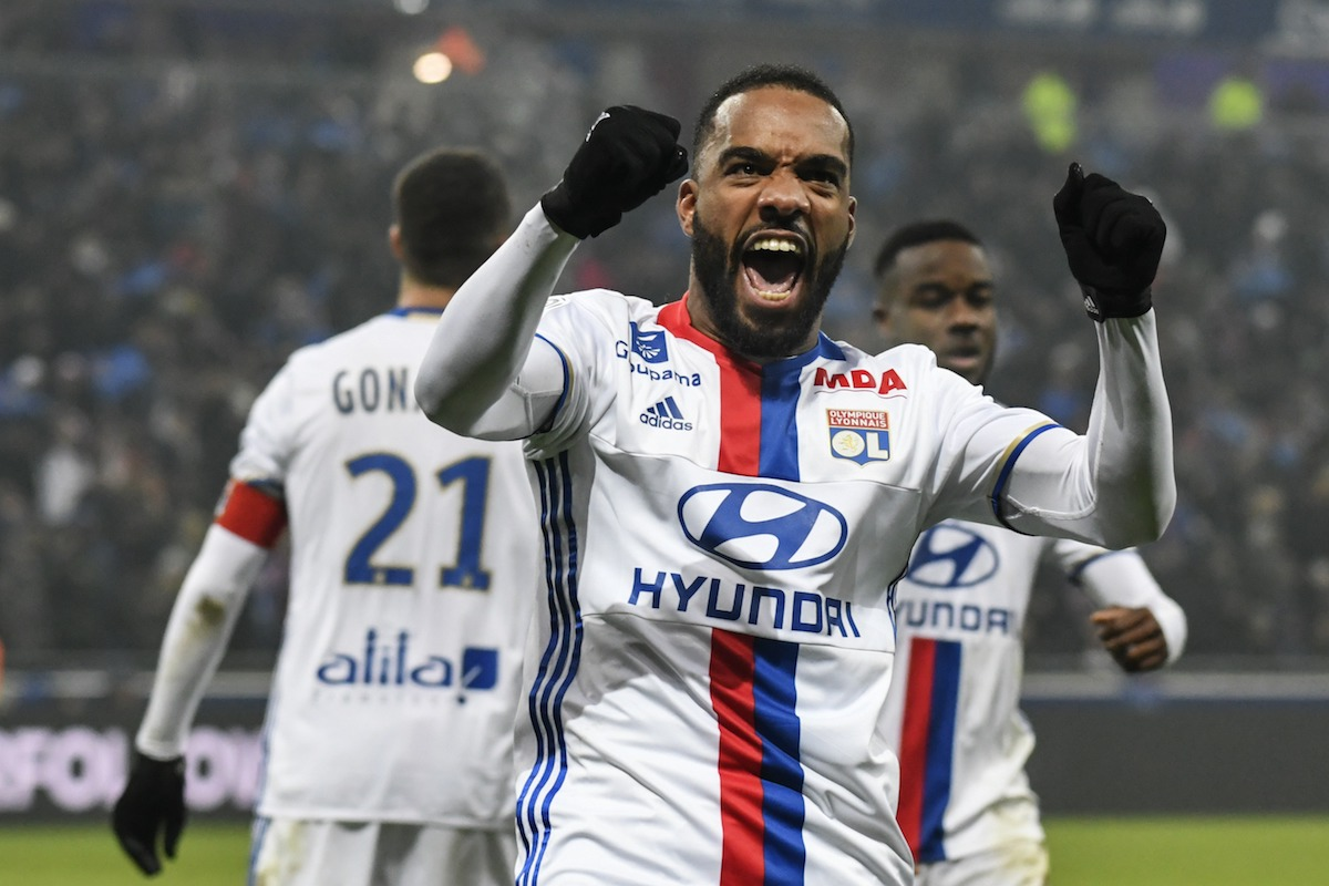 Alexandre Lacazette celebrates after scoring a goal during the French L1 football match