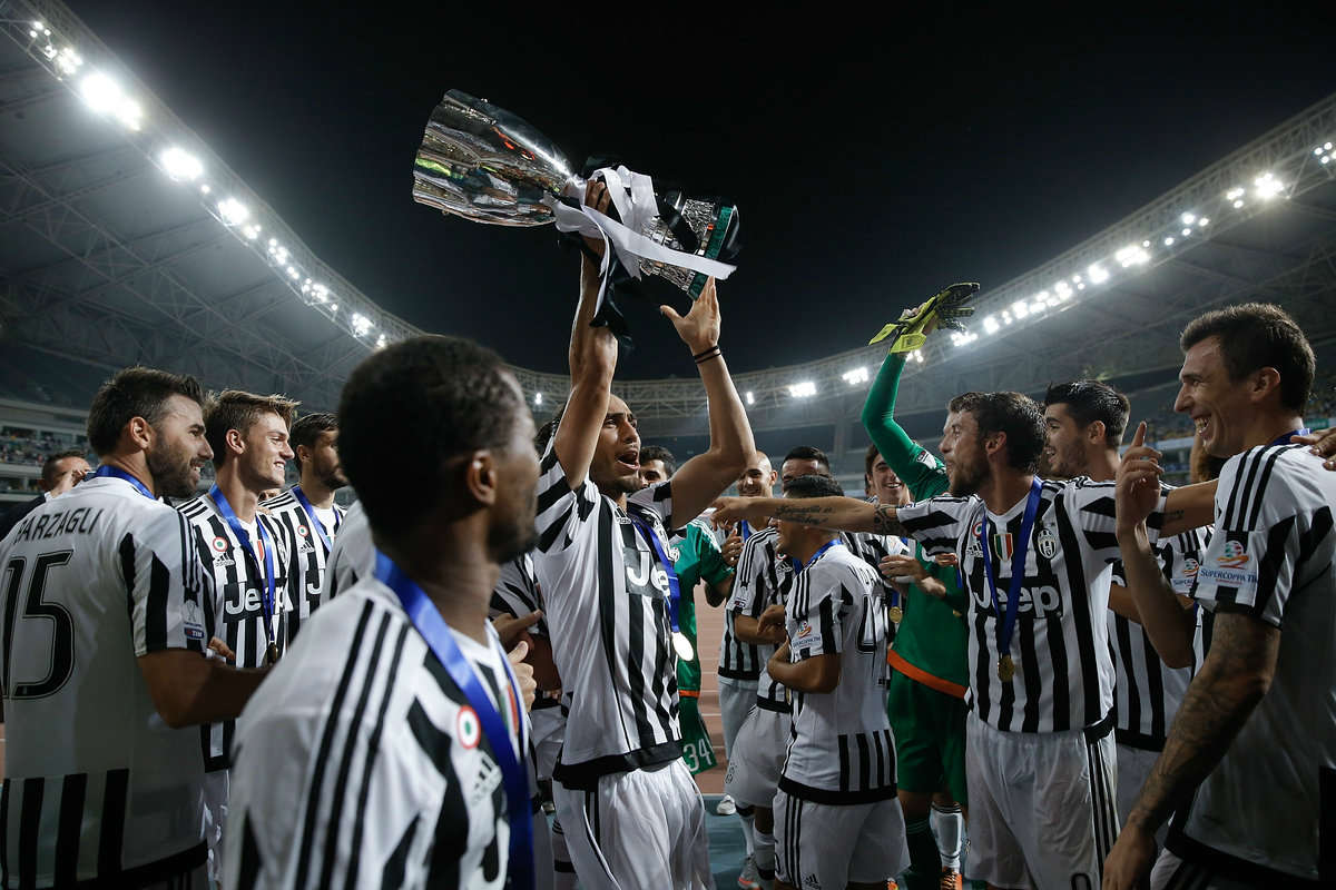 Martin Caceres lifts the 2015 Italian Super Cup