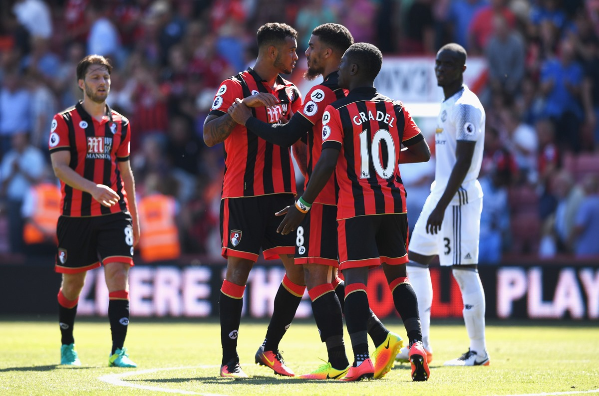 Max Gradel and Josh King celebrate for Bournemouth