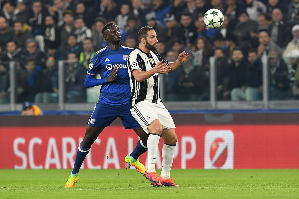 Gonzalo Higuain (R) of Juventus is challenged by Mouctar Diakhaby of Olympique Lyonnais