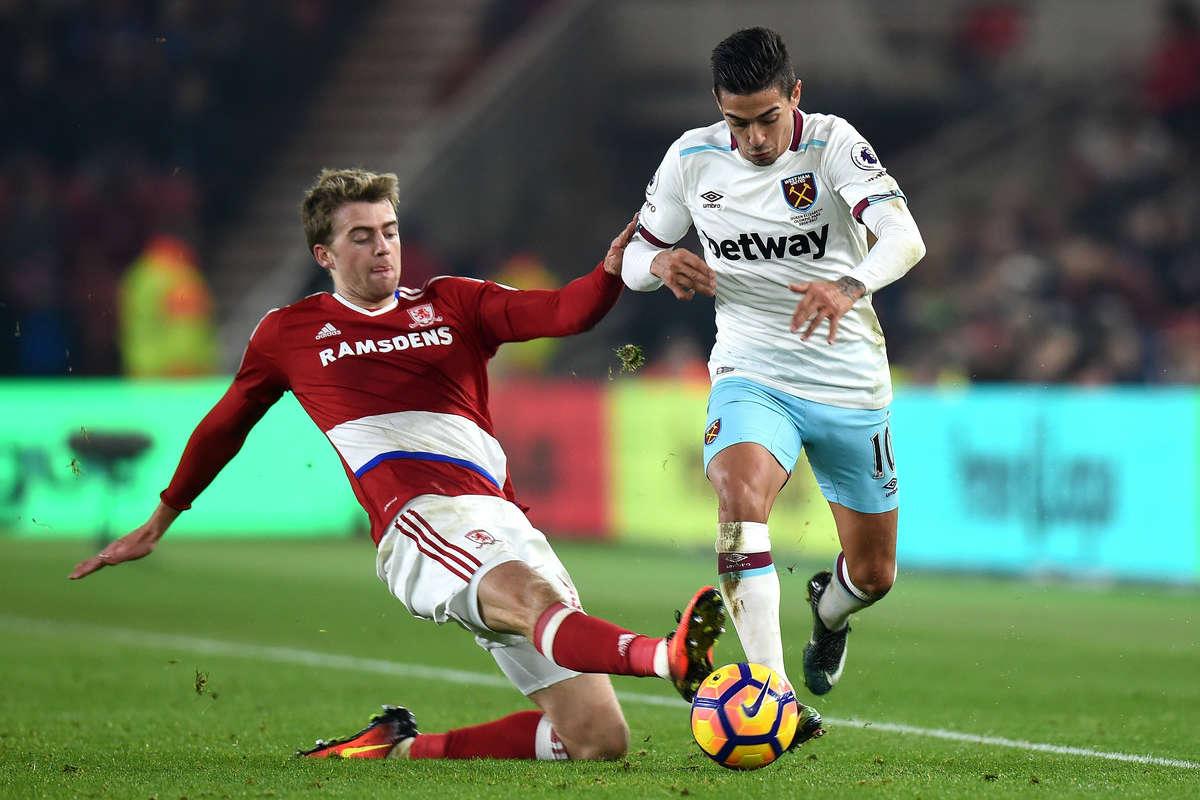 Middlesbrough's Patrick Bamford challenges Manuel Lanzini