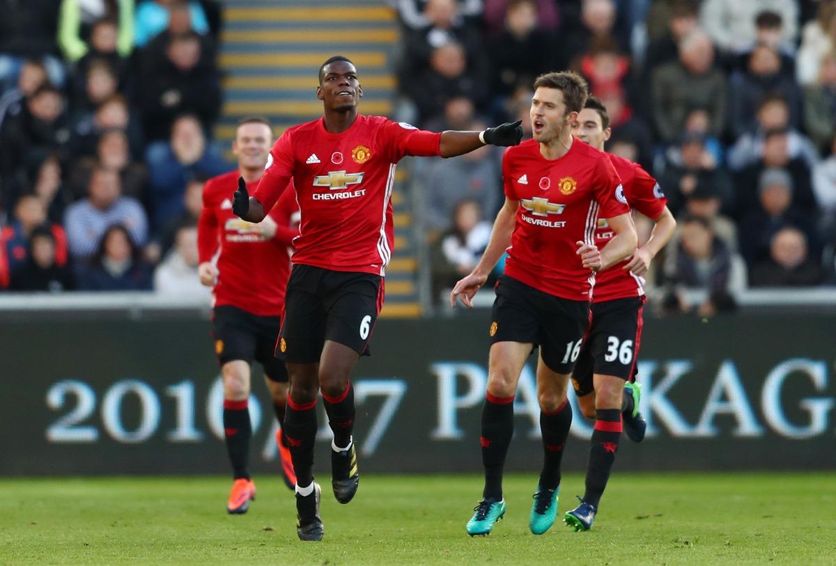 Paul Pogba celebrating with Michael Carrick