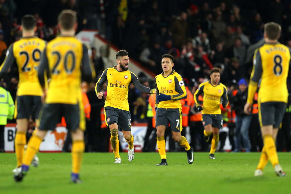 Olivier Giroud and Alexis Sanchez after scoring the equaliser against Bournemouth