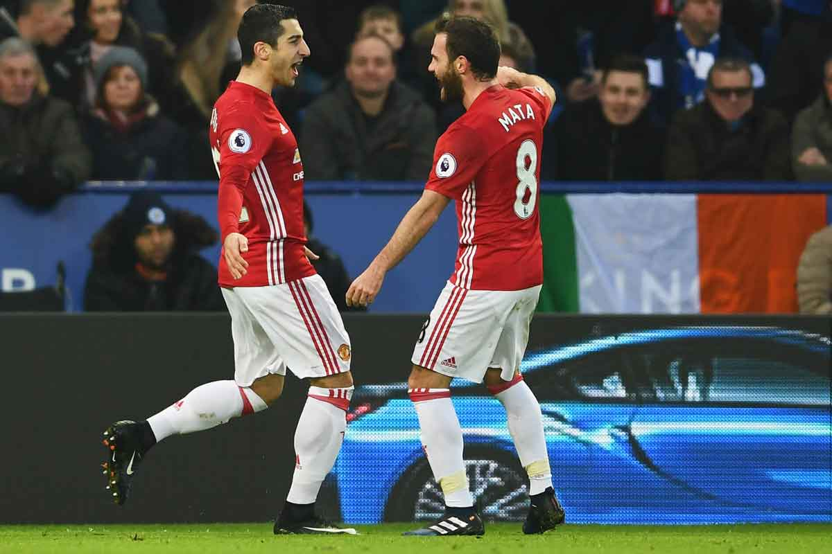 Henrikh Mkhitaryan and Juan Mata celebrate