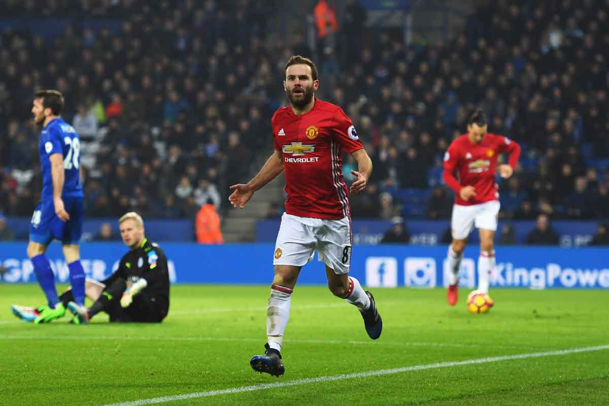 Manchester United's Juan Mata celebrates after scoring against Leicester