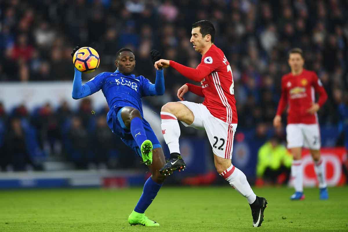 Leicester's Wilfred Ndidi tackles Manchester United's Henrikh Mkhitaryan