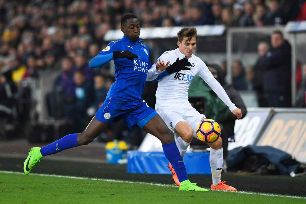 Wilfred Ndidi and Tom Carroll during Swansea 2-0 Leicester